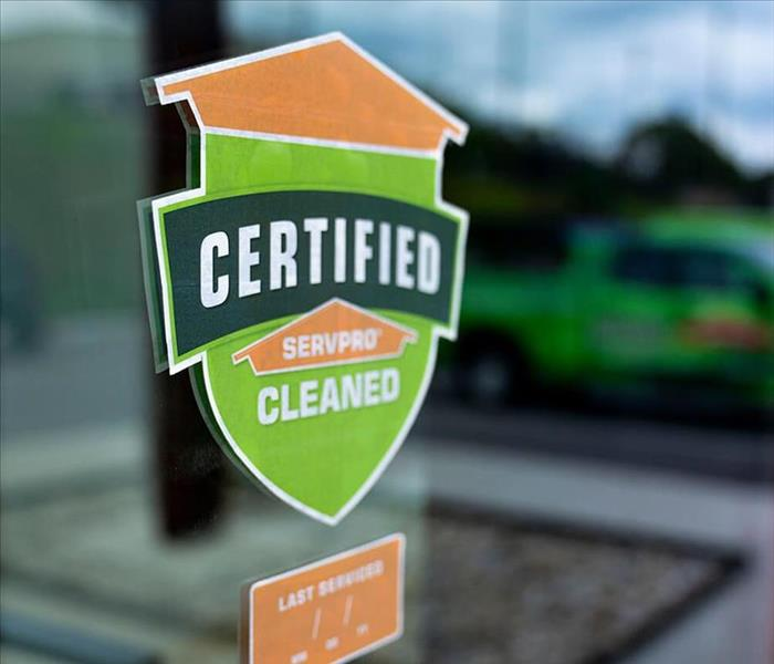 Certified: SERVPRO Cleaned decal on window of business